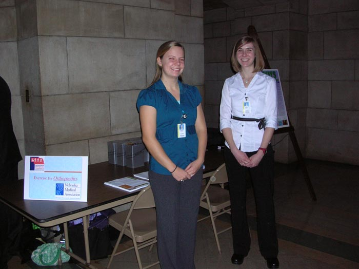 PT students Liz Pavlik and Margo Hardy at one of the education stations in the Rotunda.