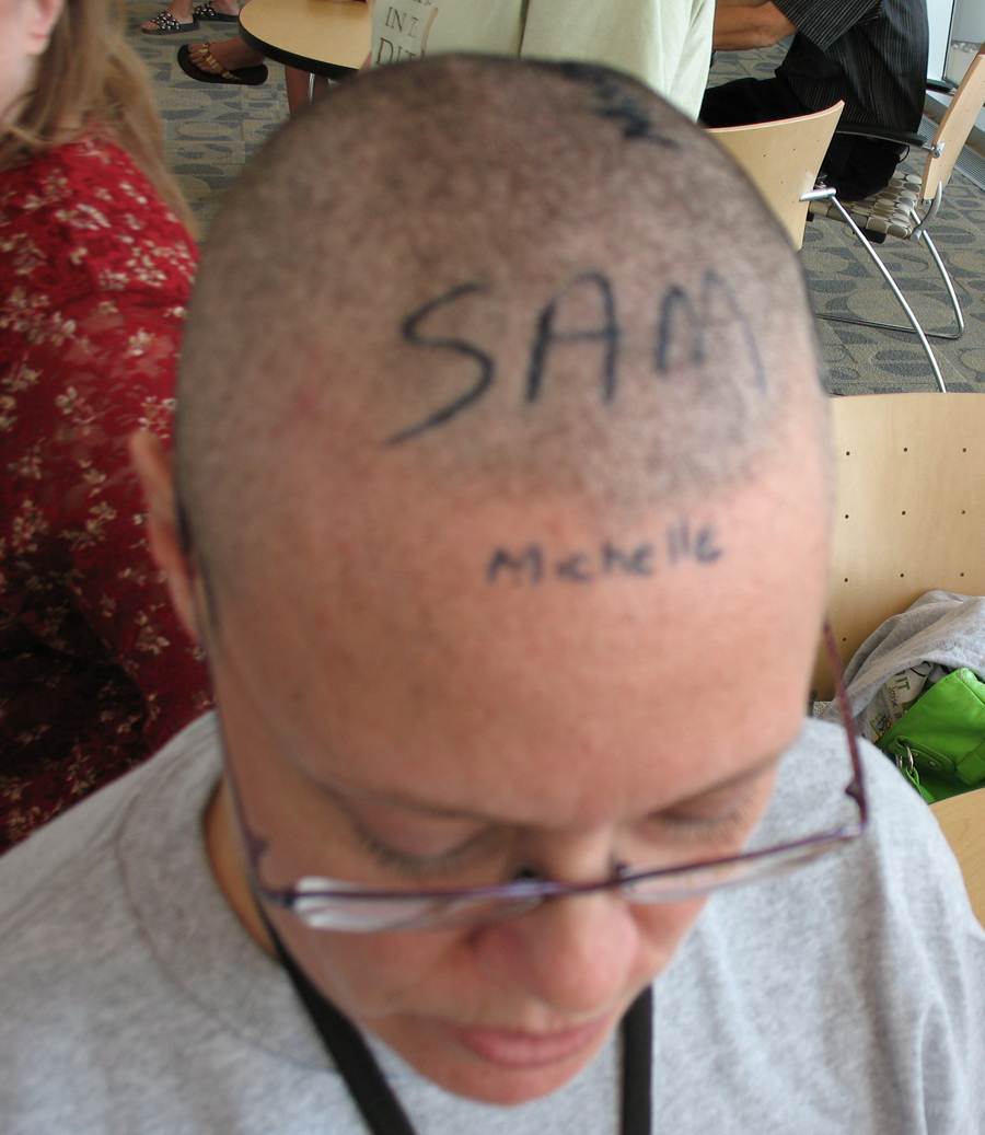 As promised, donors got to sign my head.