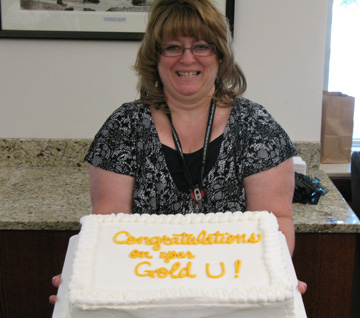 photo of Sue Prusia with a cake