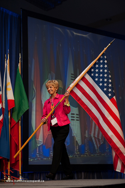 Photo of Connie Mitchell with the American Flag