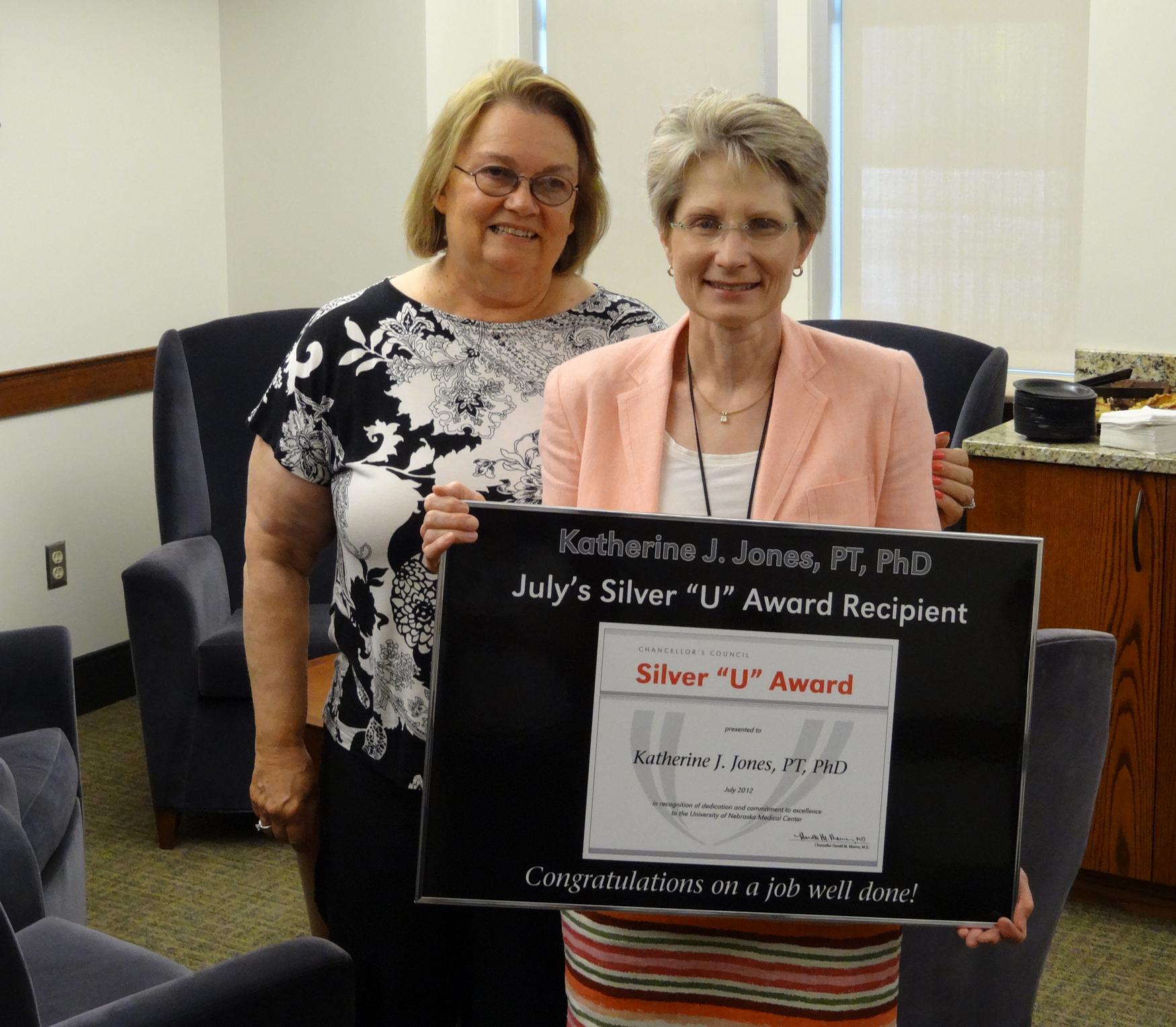 photo of Katherine Jones receiving award