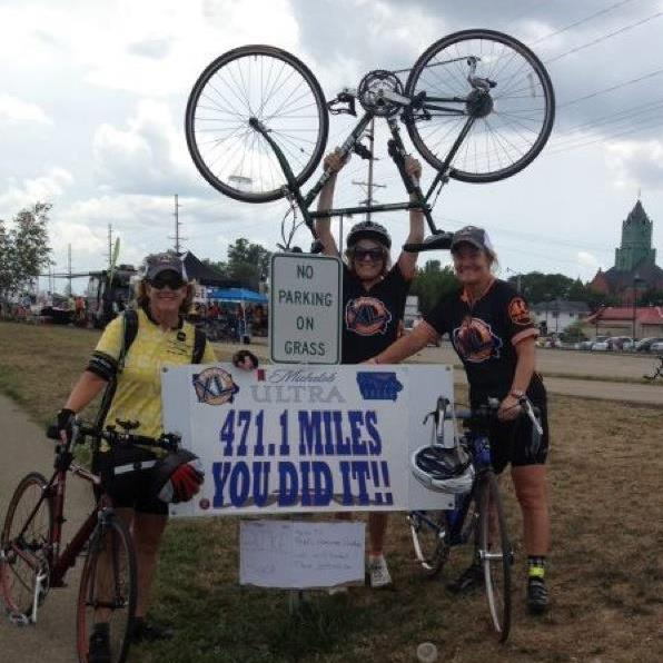 photo of Kathy Burke and her sisters at the finish of Ragbrai 2012