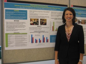 Betsy Becker with PT posters