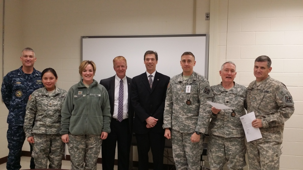 (l to r) Commander Ron Perry, PA-C, IPAP Director; Major Nouansy Wilton, MD, IPAP Faculty; Major Sharon Rosser, PA-C, IPAP Faculty; Huckabee; Meyer; Major Christopher Pase, PA-C, IPAP Faculty; Colonel George Cunningham, MD, IPAP Medical Director; and Major Vincent Antunez, PA-C, IPAP Faculty.