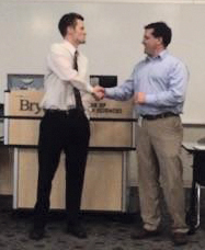 Matt Hilgers accepting the 2015 Nebraska Perfusion Society scholarship from NPS President Jeff Nichols.