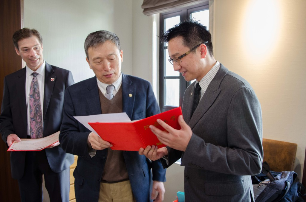 Dr. Gang Pei, president of Tongji University, presents certificate to Dr. Joseph Siu.