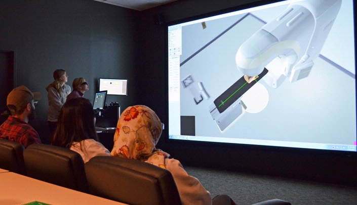 Radiation therapy students use UNMC's VERT technology in an interprofessional educational exchange with cytotechnology students.