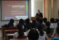Dr. Norman giving a talk in China.
