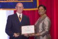 ASRT president Sandra Hayden, right, presents UNMC's James Temme with the ASRT's highest honor, the Life Member award.