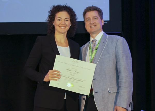 Megan Frazee receiving a certificate for her fellowship from Jim Rivard, president AAOMPT