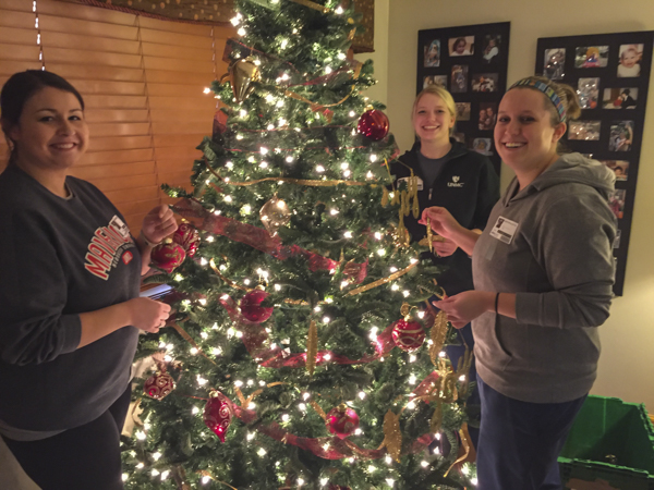 MITS students decorating one of the trees.