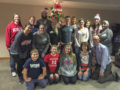 MITS students, faculty, and family volunteers with one of the holiday trees at the Ronald McDonald House.
