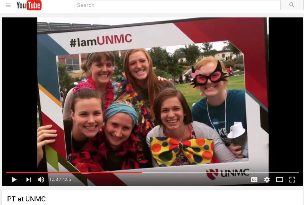 PT students at a fun event with the #IamUNMC frame