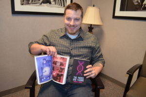 Josh Howell with his new novel.