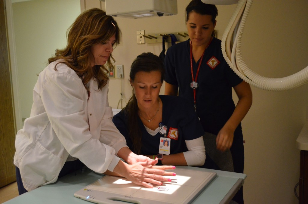 "Jones works with students Molly Gallagher and Bridgette Root, whom she calls ""the future Radiologic Technologists of the Year."""