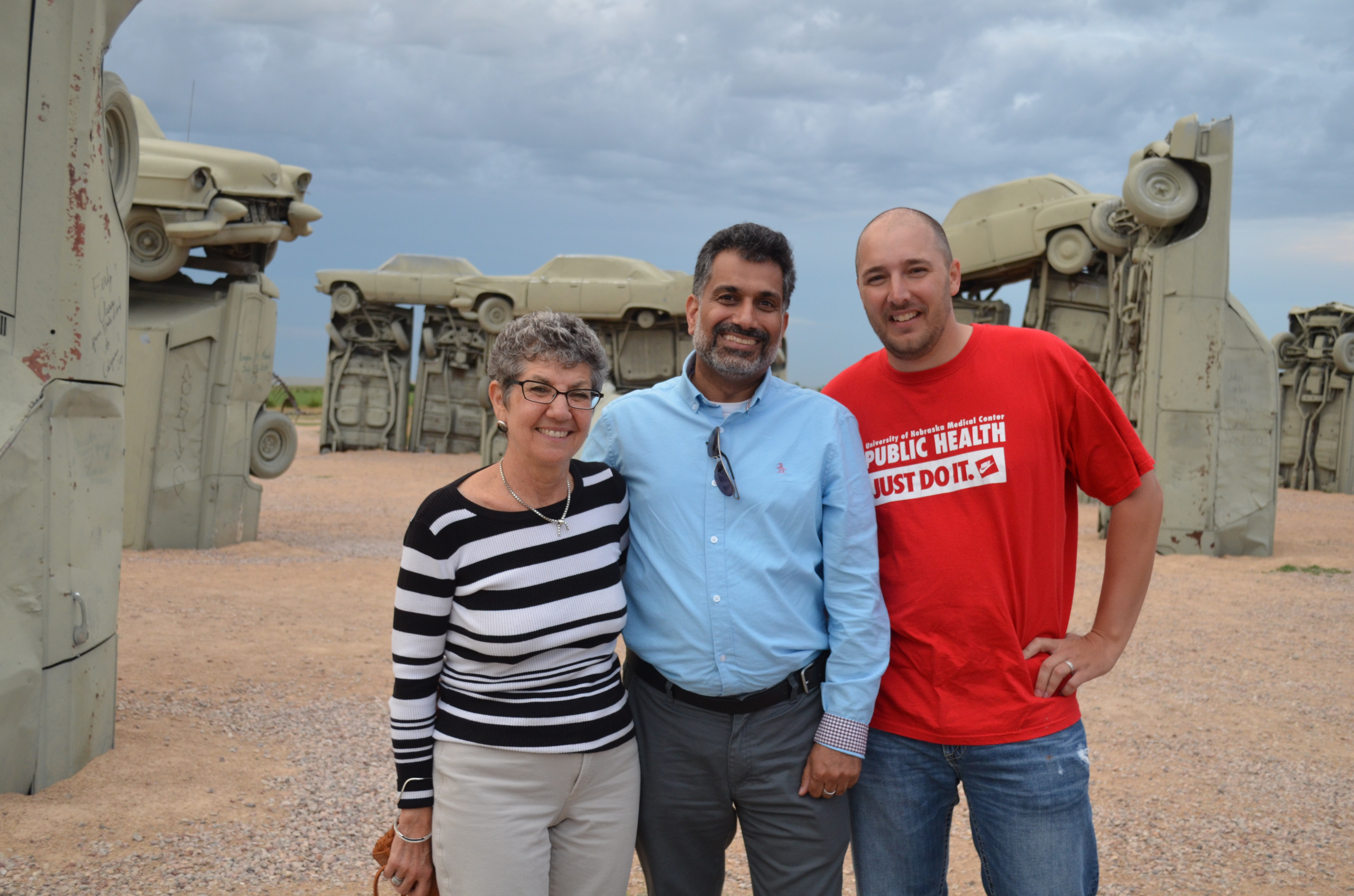 From left, Karen Levin, Dr. Khan and Brandon Grimm, Ph.D., at Carhenge.