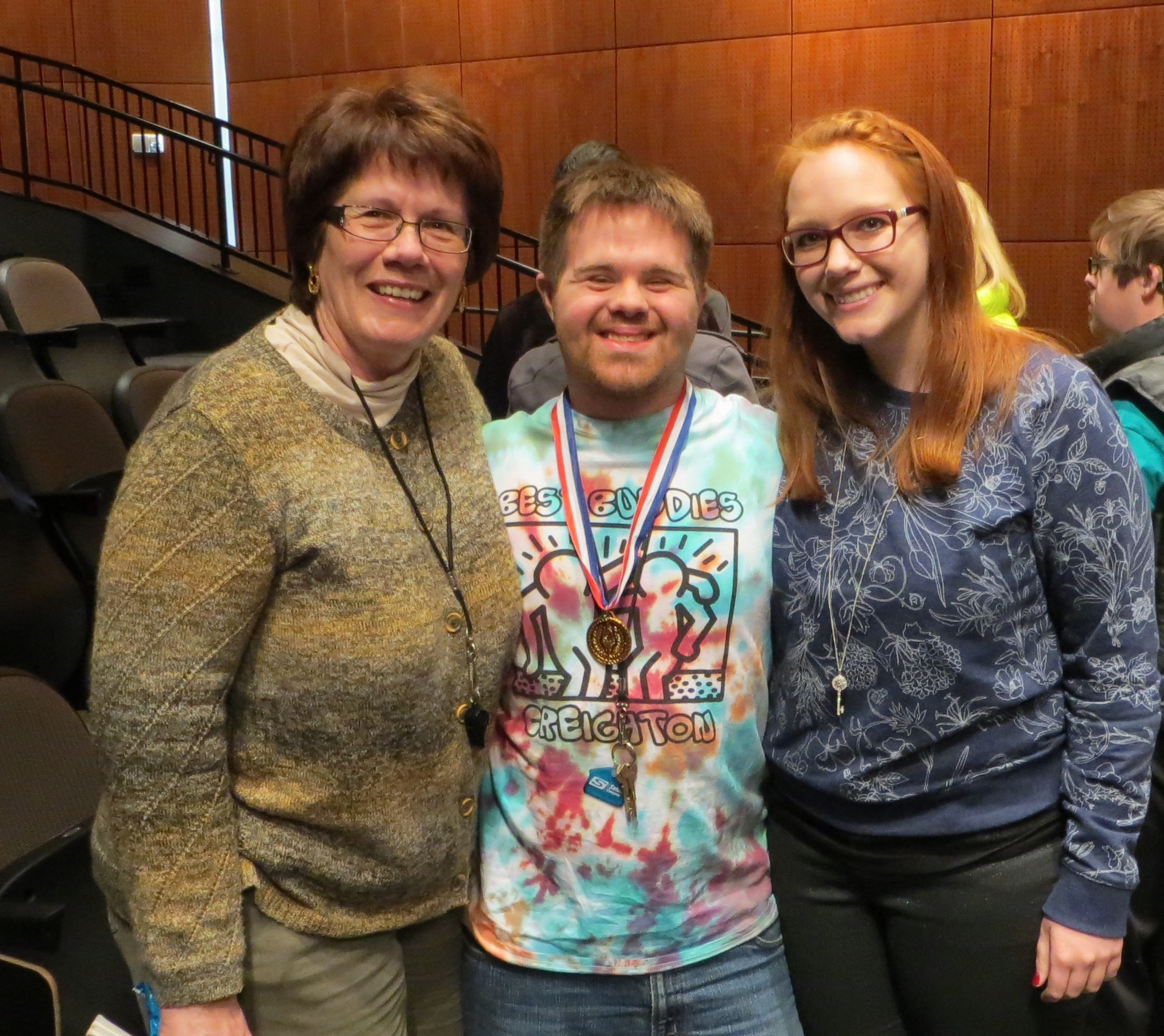 Kim and Justin with Justin's sister, Kristin, who has worked at MMI's Camp Munroe since 2010 and volunteered before that. She is now at the University of Washington in Seattle getting her master's in Speech Language Pathology. Justin's life influenced her career choice, her mother says.