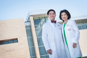 Drs. Nguyen and Do in front of the Truhlsen Eye Institute at UNMC.