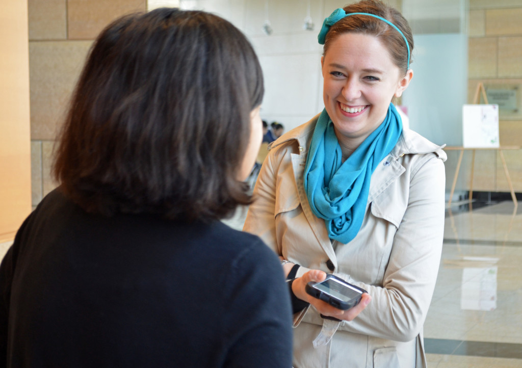 Abby Meyer, right, web content and social media specialist, makes a connection with one of UNMC's many humans.