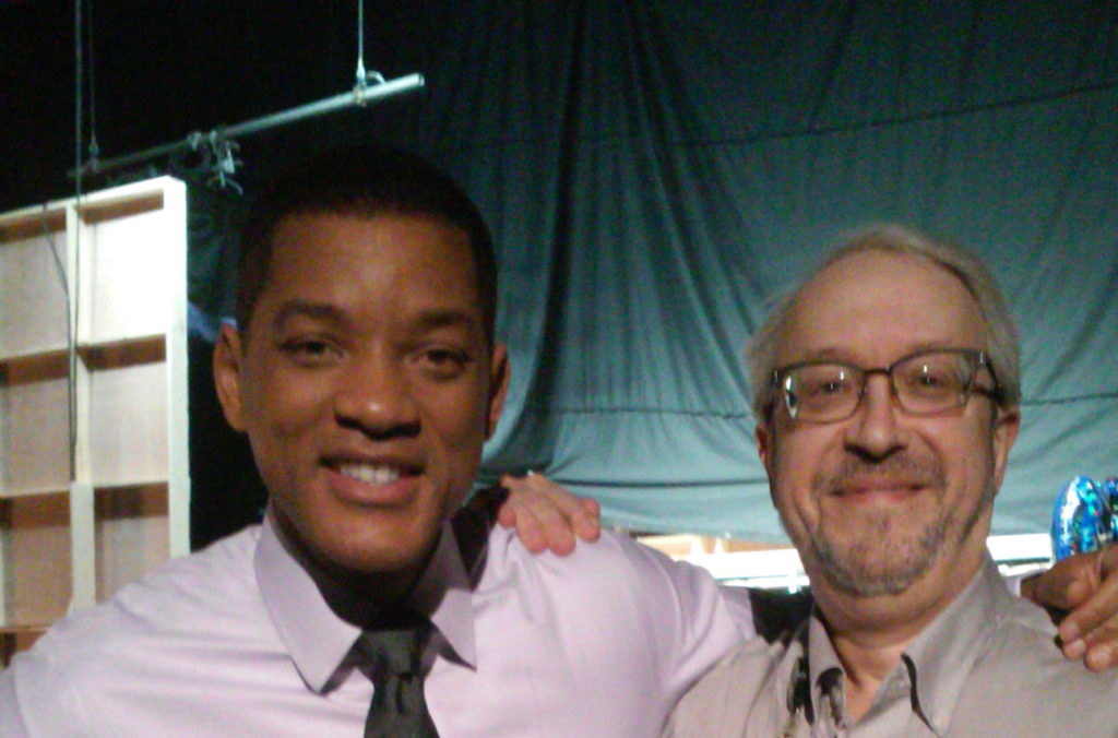 "Oscar-nominated actor Will Smith, left, and UNMC alum Dr. Ron Hamilton on the set of ""Concussion."""