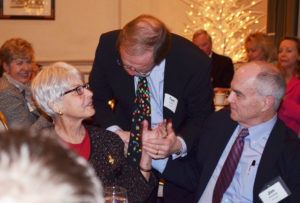 Tom Lutsey, center, thanked Nancy Armitage for all she had done for him and his family.